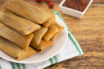 Plate Filled with Homemade Tamales Ready for Dinner on a Wooden Table