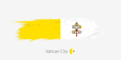 Flag of Vatican City, grunge abstract brush stroke on gray background.