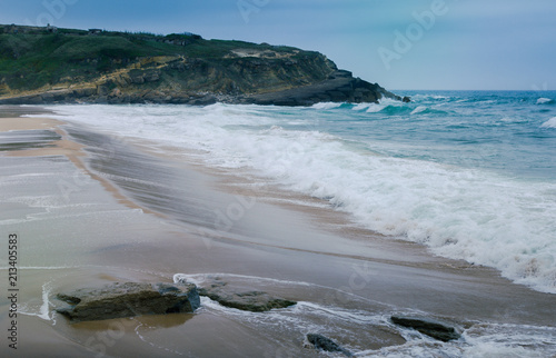 Foto Murales View of beach  with large waves near Atlantic coast. Large waves of turquoise water crushing on a beach Praia Grande, Sintra, Portugal. Travel concept. Vintage effect.