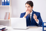Young handsome businessman employee working in office at desk - 213410320