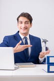 Young handsome businessman employee working in office at desk - 213410359
