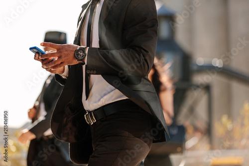 Poster Man using mobile phone while walking on street