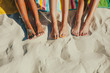 Close up of legs of three women at the beach