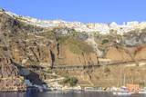 Port of Thira and Thira town together with the road from port to city and cable in Santorini island, Greece - 213418315