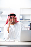 Arab businessman working in the office - 213425577