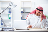 Arab businessman working in the office - 213425584