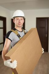 Man in hard hat hold cardboard box