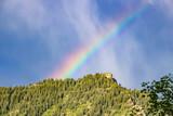 Rainbow behind Utah mountain at dawn - 213430314