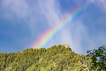 Rainbow behind Utah mountain at dawn