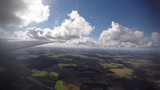 Clip of the outside wing view from the cabin of a glider. - 213432725