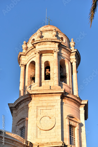 Foto Murales The Poniente or West Tower is one of two bell towers of Cadiz Cathedral, Spain