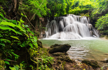 Beautiful waterfall in tropical rainforest at Kanchanaburi province, Thailand © sasinparaksa