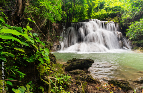 Beautiful waterfall in tropical rainforest at Kanchanaburi province, Thailand - 213459311