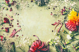 Beautiful summer garden flowers frame on green background, top view - 213466546