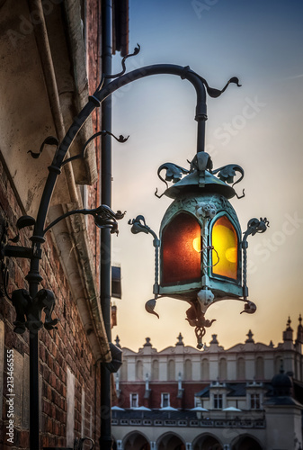 Old lantern stuck to the facade of an St. Mary's Basilica in Krakow, Poland. © Tryfonov