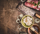 Raw meat with  Butcher Cleaver and ingredients for meat grilling on rustic wooden background, top view - 213466721