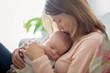 Leinwanddruck Bild - Young mother, holding tenderly her newborn baby boy