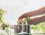Female woman hand making  seasonal traditional  syrup of elderberry flowers - 213470119