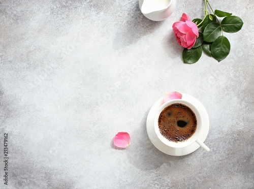 Poster Coffee. Happy morning with cup of coffee and pink rose. Overhead view, copy space.