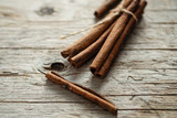 a cinnamon is spicy fragrant on a table with a mestome for a background - 213479930