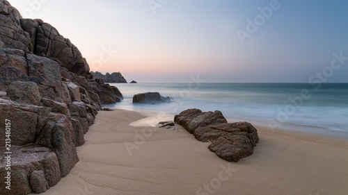 Foto Murales Stunning vibrant sunrise landscape image of Porthcurno beach on South Cornwall coast in England