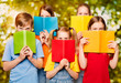Children Read Books, Group of Kids Eyes behind Open Blank Book Cover, Girls and Boys Students Looking at Camera - 213483548