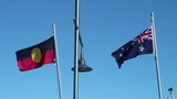 Australian and Australian Aboriginal flags blowing gently in the breeze side by side - 213490341