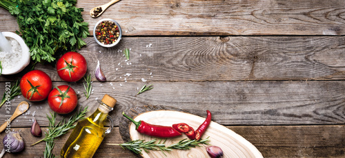 Raw organic vegetables with fresh ingredients for healthily cooking on vintage background, top view, banner. Vegan or diet food concept. Background layout with free text space. - 213495921