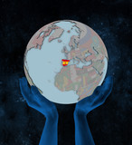 Spain on political globe in hands