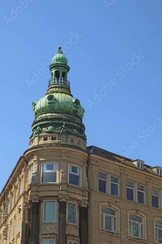 Foto Murales Copenhagen, Denmark - view of  an antique building tower in city center with the green copper decorated cover characteristic of the city profile