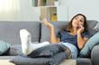 Leinwanddruck Bild - Disabled woman talking on phone at home