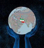 Iran on political globe in hands