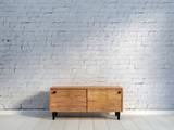 vintage wooden commode at brick wall - 213506904