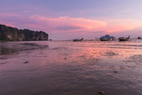Beach and sunset at Ao Nang beach, Krabi, Thailand with traditional thai boat - 213509956