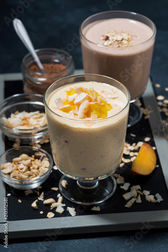 Canvas Milkshake milkshakes with chocolate, oatmeal and mango in glasses, vertical