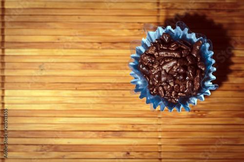 Aluminium Koffiebonen Gourmet chocolate truffle (Brigadeiro Gourmet in portuguese) on woody background top view