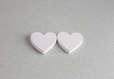 two wooden hearts on craft background - 213516140
