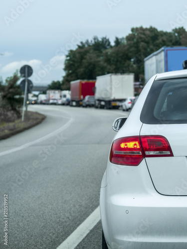 Wall mural Rosalina, Italy - July, 11, 2018: traffic jam on a country road in Rosolina, Italy