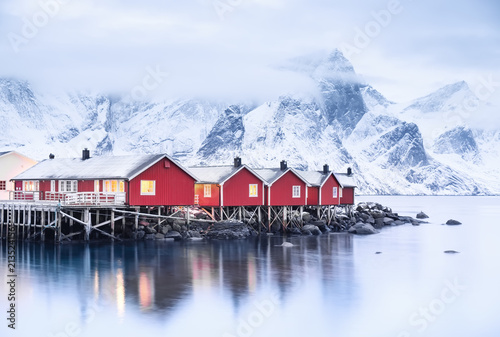 Fototapeta Houses in the Lofoten islands bay. Natural landscape during sunrise
