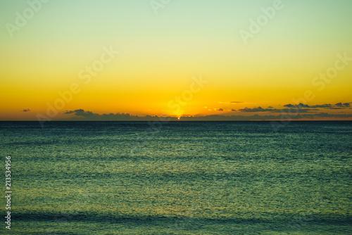 Plexiglas Zonsopgang Sunset or sunrise over sea surface