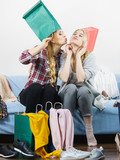 Two happy female friends after shopping - 213535339