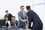 handshake business partners at a business meeting - 213552901