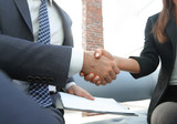 Close-up of two business people shaking hands - 213553352