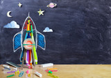 Startup - Rocket Drawing With School Supplies On Table