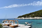 Tropical style wooden beach tent with loungers on the island of Hvar, Croatia, June, 2018 - 213556374