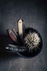Unique barber equipment with grey soap, razor and brush