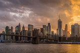 Sunset view of Brooklyn Bridge with lower Manhattan skyline in background on East River, NYC - 213560152