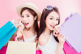two women take shopping bags