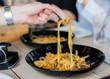 Spaghetti meat sauce. Hand using fork eating Spaghetti