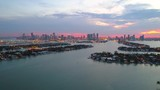 Drone footage scenic Miami sunset water islands and downtown view 4k - 213570193